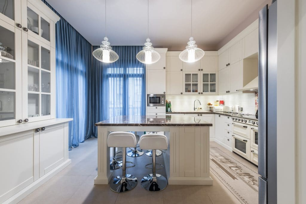 White kitchen with blue curtains