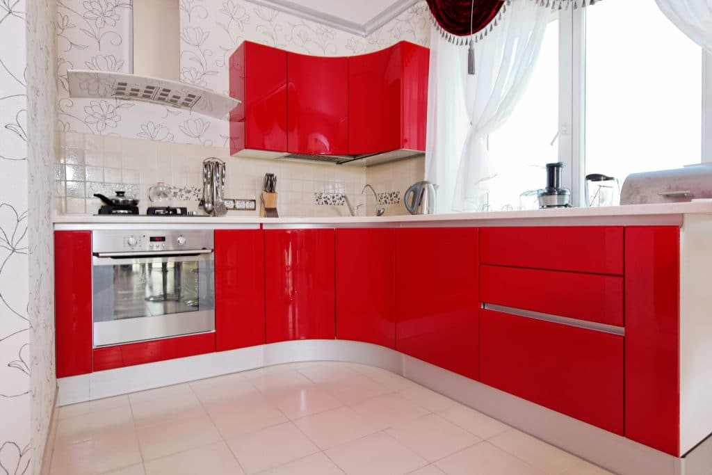 white kitchen with red cabinets